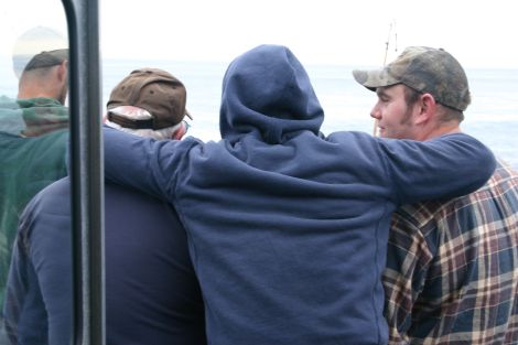 A good day...  A man and his two sons, our co-fisherman, pretty enthusiastic ones, hanging out at the back of the boat.