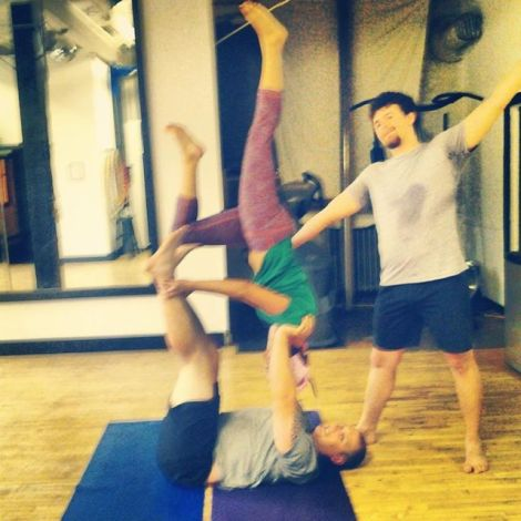 Grainy photo but awesome moment in AcroYoga for me.  Shoulder stand.  So empowering.  Photo taken by Qassandra of Minneapolis Acro with Dan & Cassandra.