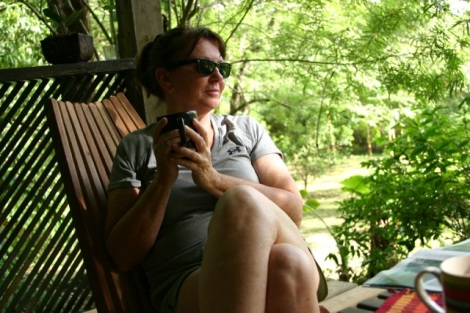 Mom sitting in the common area, sipping on some coffee, and looking out on the river.